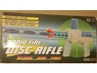 Rapid disc firing toy gun