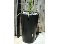 Brand new black Ecosure water butt with planter