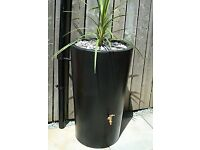Smart looking brand new large black 180 litre water butt with inbuilt planter on the top