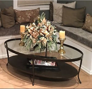 Oval glass and iron coffee table