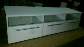 A brand new 3 door white finish TV unit with led light.