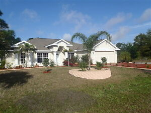 South Gulf Cove Canal Home with Pool