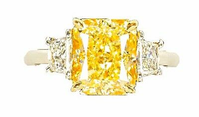 GIA FANCY LIGHT YELLOW 4.01 CT RADIANT VVS1 CLARITY GRADE .58 CT SIDE TRAPEZOID