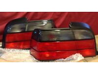 PAIR OF BMW E36 COUPE SMOKED REAR LIGHTS.
