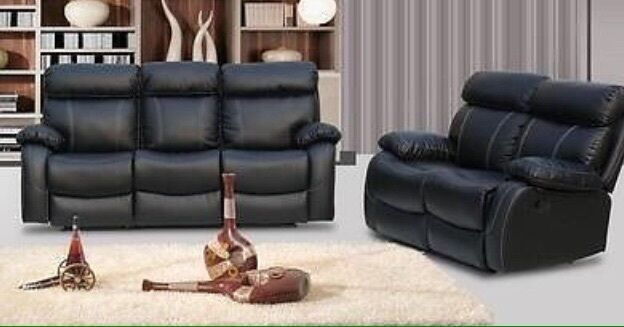 milano black brand new leather recliner sofas in taplow