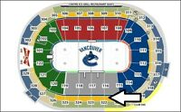 Canucks Sec 322 3rd ROW- pair front faceoff circle Kings Apr 4