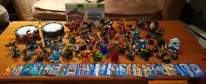 Skylanders figure lot with games, portals,  and character cards.