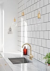 Brand new polished brass kitchen faucet