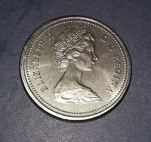 1975 CANADIAN DOLLAR COIN, VERY GOOD CONDITION