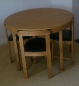 Table & 4 Chairs. Very modern design. Perfect fit for all rooms