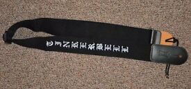 "Black guitar strap embroidered with the name ""Tinkerbelle"""