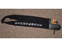 """Black guitar strap embroidered with the name """"Tinkerbelle"""""""