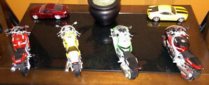 Four 1:12 Diecast Model Motorcycles