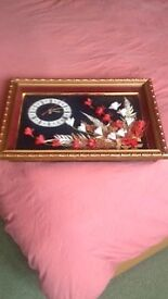Clock in golden carving frame with beautiful flowers arrangement
