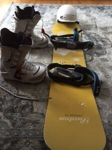 Snowboard, bindings, boots, and helmet