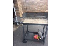 Family size charcoal barbeque, on wheels with shelves