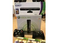 Xbox 360 bundle includes kinect, controllers, headphones, 20 games