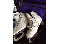 Ice skates size 5 with bag, blade covers and boot covers. Open to offers