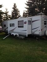 Jay Flight Travel Trailer, with shed, deck and wood