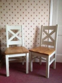 Pair of solid oak dining chairs, made from recycled oak.