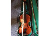 Suzuki Violin 4/4, 2 bows, case. Inside is written Copy of Antonius Stradivarus 1720 Anno 1980
