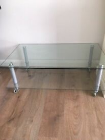 Glass TV/ Coffee table with wheels. easy to move. Excellent condition