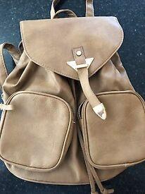 Tan rucksack