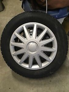 Snow tires with hubcaps and TPMS