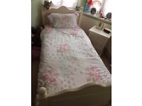 Two matching solid wooden Single Beds painted antique white, used but good condition