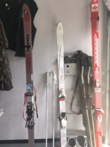 3 Pairs of Ski Boot and poles one Telemart for pounder