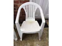 Four white plastic garden chairs