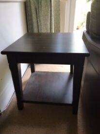 IKEA dark brown wooden coffee table with magazine shelf