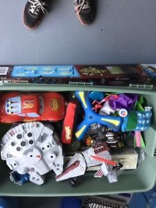 Assorted bin of toys
