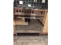 Lofra freestanding range cooker with 5 ring gas hob and 9 multi function electric oven