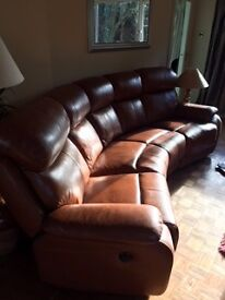 LEATHER 4 SEATER SOFA - WITH MATCHING STORAGE POUFFE AND ELECTRIC RECLINING END SEATS.