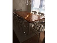 Heavy Pine Dining table with 6 or 8 Chairs