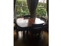Victorian extending dining table and 6 chairs.