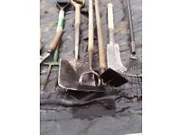 selection of garden hand tools