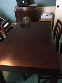 Solid Rosewood dining table and 4 chairs