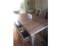 Dining table with 4 Oak & Brown Seats 6 months old and Excellent condition..