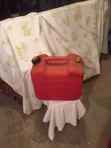 2 - 5 gal gas containers