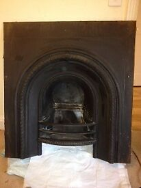 Cast Iron fire insert( London Acquisitions) and timber surround.Can be sold separately