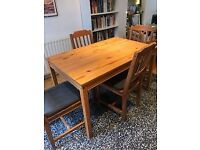 Ikea dining table and 4x chairs with grey cushion covers