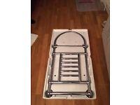 Heated plumed chrome towel rail