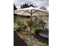 **GARDEN PARASOL**AND**CAST IRON BASE**LOVELY**