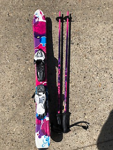 Little kid's skis and poles