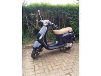 Vespa 125 Moped Metallic Blue