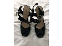 Black Patent red herring sandals size 6. Never worn