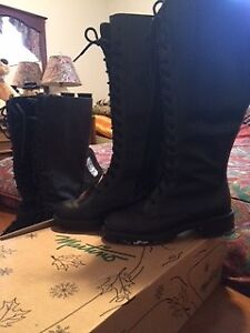 two pair of high top winter boots