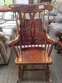 Dark wood rocking chair at Cambridge Re-Use (reuse)